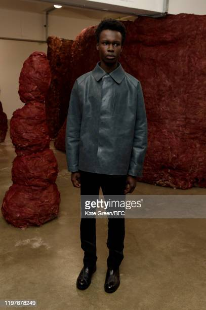A model walks the runway at the Omar Afridi Presentation during London Fashion Week Men's January 2020 at the Dray Walk Gallery on January 05 2020 in...
