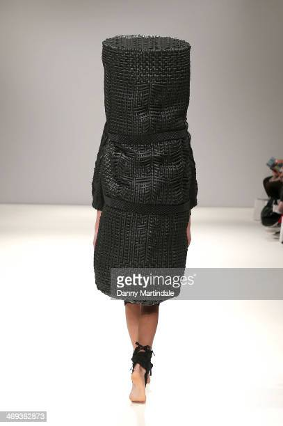 A model walks the runway at the Ones To Watch show at the Fashion Scout venue during London Fashion Week AW14 at Freemasons Hall on February 14 2014...