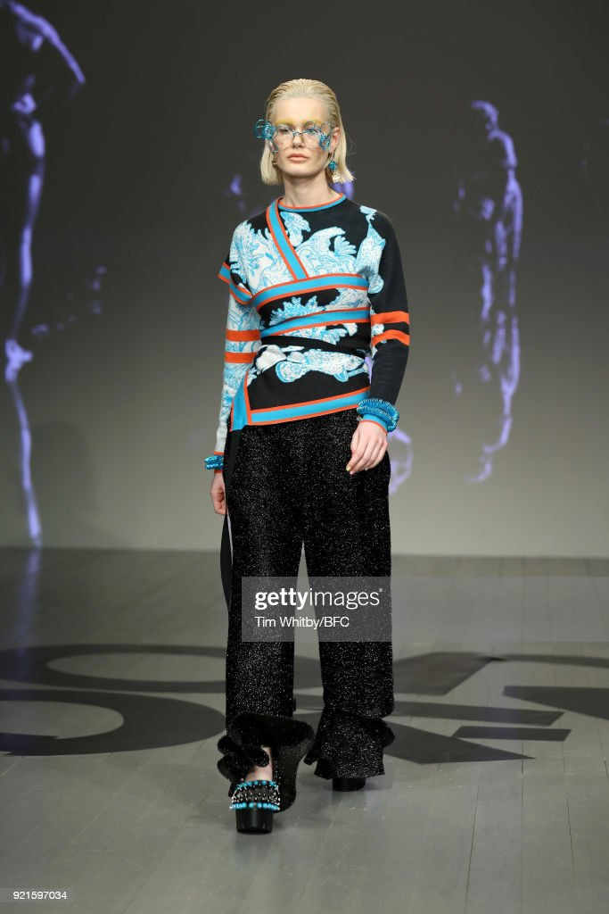 A model walks the runway at the On|Off Presents - Longshaw Ward show during London Fashion Week February 2018 at BFC Show Space on February 20, 2018 in London, England.