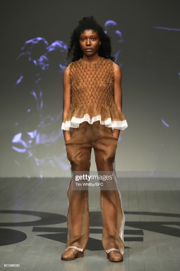 A model walks the runway at the On|Off Presents - This is the Uniform fashion show during London Fashion Week February 2018 at BFC Show Space on February 20, 2018 in London, England.