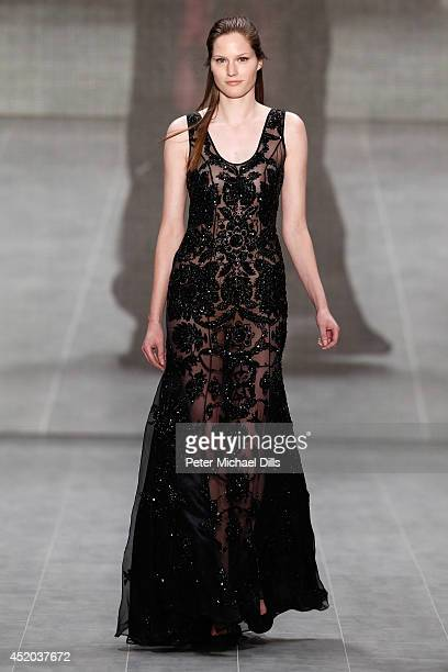A model walks the runway at the Opening Night by Grazia fashion show during the MercedesBenz Fashion Week Spring/Summer 2015 at Erika Hess Eisstadion...