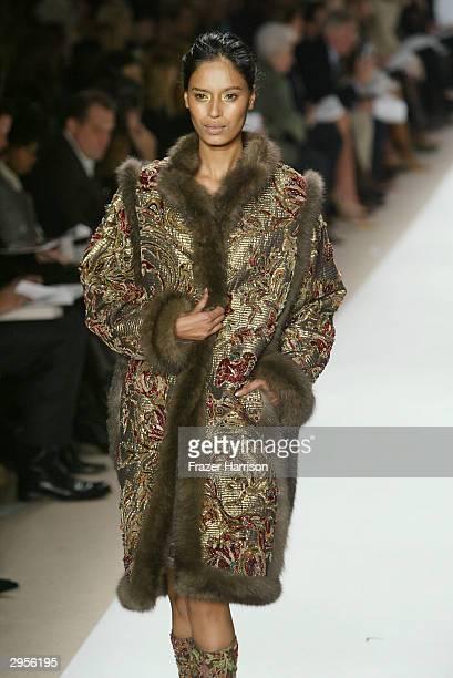 A model walks the runway at the Oscar De La Renta fashion show during Olympus Fashion Week at Bryant Park February 9 2004 in New York City