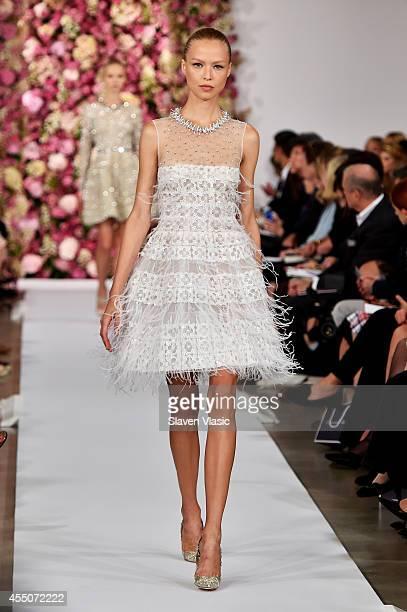 A model walks the runway at the Oscar De La Renta fashion show during MercedesBenz Fashion Week Spring 2015 on September 9 2014 in New York City