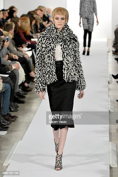 A model walks the runway at the Oscar De La Renta fashion show during MercedesBenz Fashion Week Fall 2014 on February 11 2014 in New York City