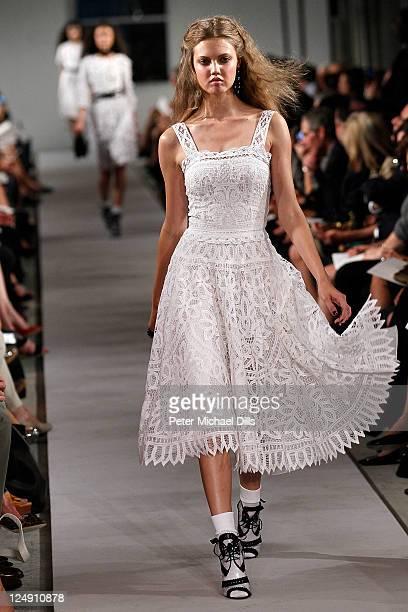 A model walks the runway at the Oscar De La Renta Spring 2012 fashion show during MercedesBenz Fashion Week on September 13 2011 in New York City