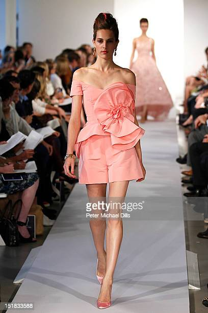 A model walks the runway at the Oscar de la Renta spring 2013 fashion show during MercedesBenz Fashion Week on September 11 2012 in New York City