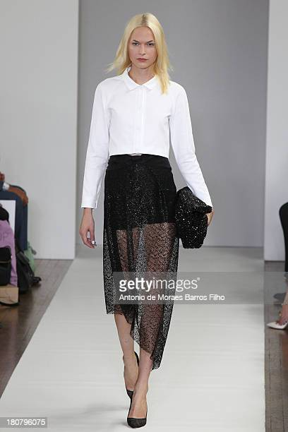 A model walks the runway at the Osman show during London Fashion Week SS14 on September 16 2013 in London England