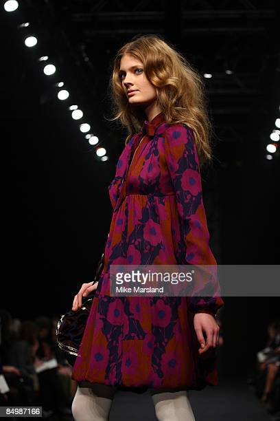 Model walks the runway at the Ossie Clark show during London Fashion Week Autumn/Winter 2009 at Natural History Museum on February 23 2009 in London...