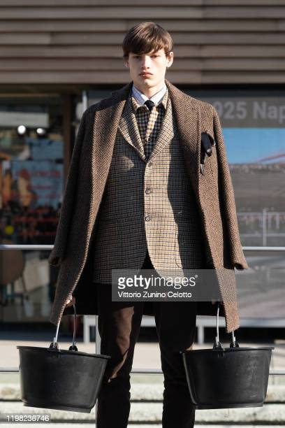 A model walks the runway at the Otherwise Formal fashion show during Pitti Immagine Uomo 97 at Fortezza Da Basso on January 08 2020 in Florence Italy