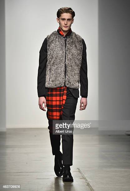 A model walks the runway at the Ovadia Sons runway show during MercedesBenz Fashion Week Fall 2015 at Pier 59 on February 16 2015 in New York City