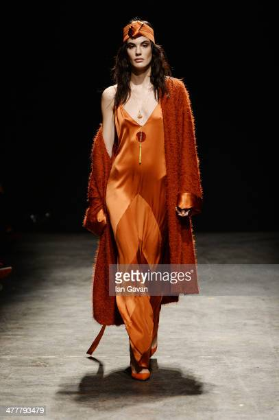 A model walks the runway at the Ozlem Ahiakin show during MBFWI presented by American Express Fall/Winter 2014 on March 11 2014 in Istanbul Turkey