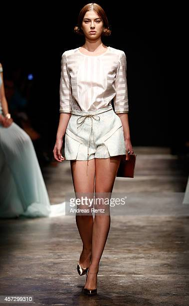 A model walks the runway at the Ozlem Erkan show during Mercedes Benz Fashion Week Istanbul SS15 at Antrepo 3 on October 16 2014 in Istanbul Turkey