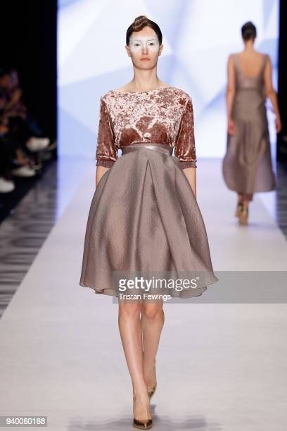 A model walks the runway at the Ozlem Erkan show during Mercedes Benz Fashion Week Istanbul at Zorlu Performance Hall on March 30 2018 in Istanbul...