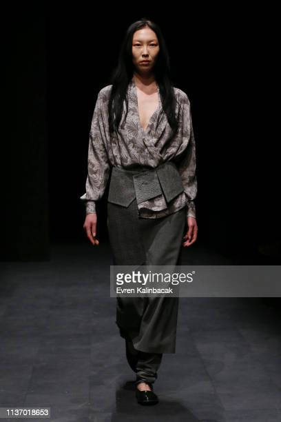 A model walks the runway at the Ozlem Erkan show during MercedesBenz Istanbul Fashion Week at the Zorlu Performance Hall on March 20 2019 in Istanbul...