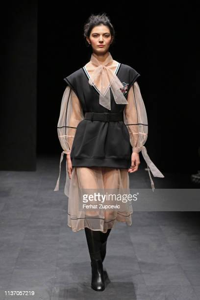 A model walks the runway at the Ozlem Kaya show during MercedesBenz Istanbul Fashion Week at the Zorlu Performance Hall on March 20 2019 in Istanbul...