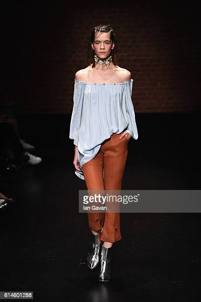 A model walks the runway at the Ozlem Kaya show during MercedesBenz Fashion Week Istanbul at Zorlu Center on October 14 2016 in Istanbul Turkey