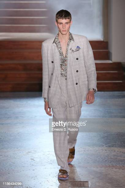 A model walks the runway at the Pal Zileri fashion show during the Milan Men's Fashion Week Spring/Summer 2020 on June 17 2019 in Milan Italy