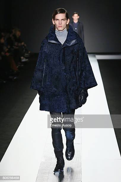 A model walks the runway at the Pal Zileri show during Milan Men's Fashion Week Fall/Winter 2016/17 on January 16 2016 in Milan Italy