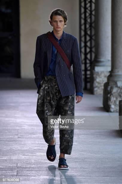 Model walks the runway at the Pal Zileri show during Milan Men's Fashion Week Spring/Summer 2019 on June 18, 2018 in Milan, Italy.