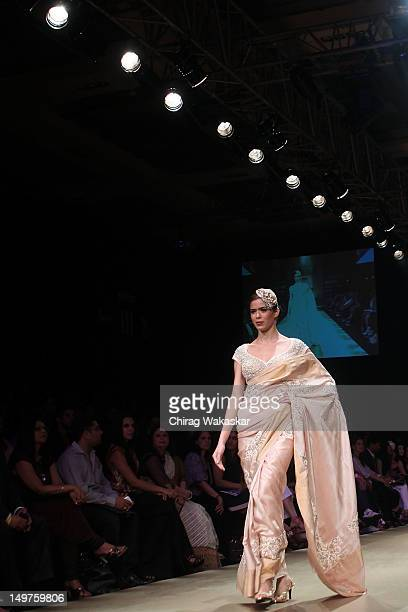 A model walks the runway at the Pallavi Jaikishan show at The Lakme Fashion Week Winter/Festive 2012 day 1 at the Grand Hyatt on August 3 2012 in...