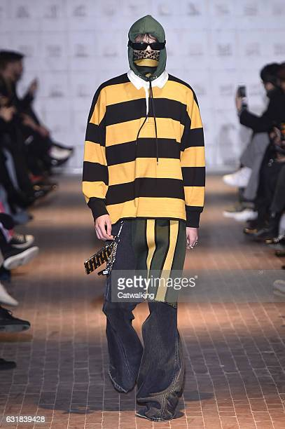 Model walks the runway at the Palm Angels Autumn Winter 2017 fashion show during Milan Menswear Fashion Week on January 16, 2017 in Milan, Italy.