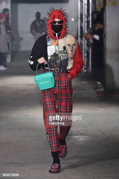 A model walks the runway at the Palm Angels Autumn Winter 2018 fashion show during Milan Menswear Fashion Week on January 14 2018 in Milan Italy