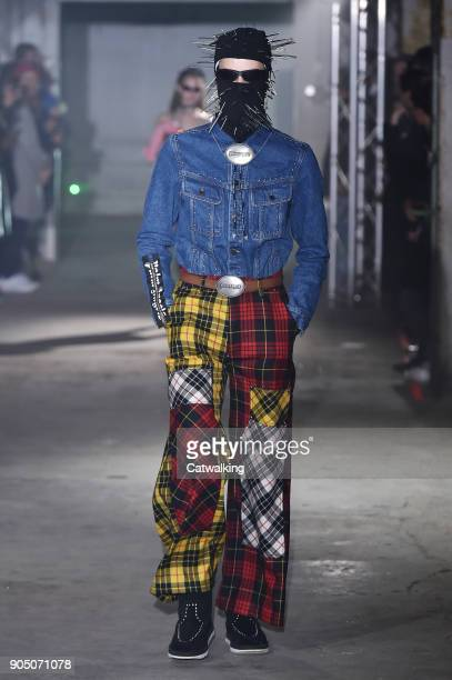 Model walks the runway at the Palm Angels Autumn Winter 2018 fashion show during Milan Menswear Fashion Week on January 14, 2018 in Milan, Italy.