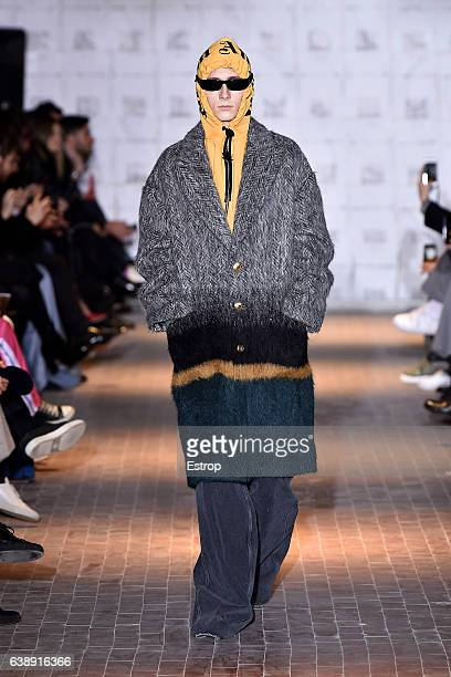 Model walks the runway at the Palm Angels show during Milan Men's Fashion Week Fall/Winter 2017/18 on January 16, 2017 in Milan, Italy.