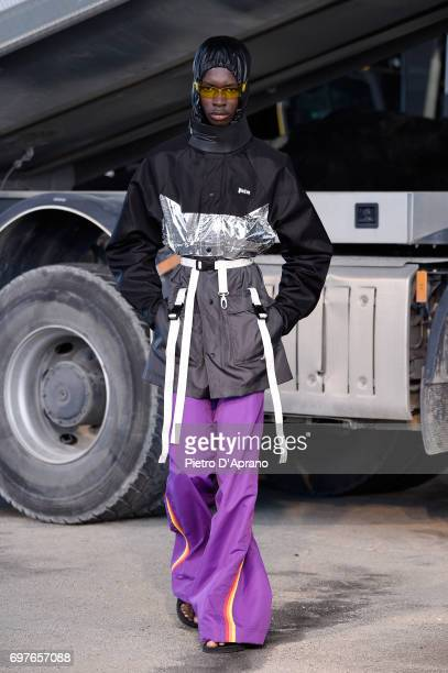 A model walks the runway at the Palm Angels show during Milan Men's Fashion Week Spring/Summer 2018 on June 19 2017 in Milan Italy