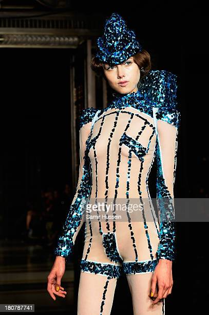 A model walks the runway at the Pam Hogg show during at the Fashion Scout venue during London Fashion Week SS14 at Freemasons Hall on September 16...