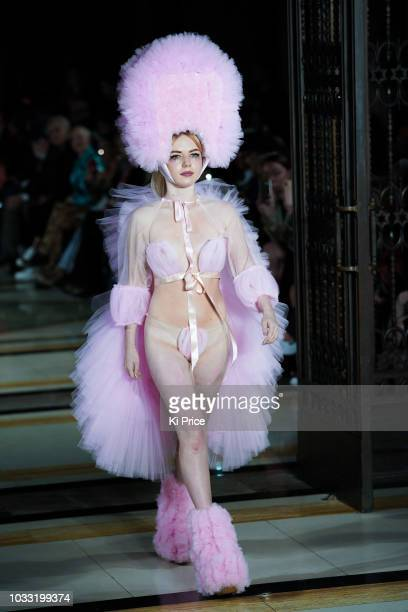 Model walks the runway at the Pam Hogg Show during London Fashion Week September 2018 at Freemasons Hall on September 14 2018 in London England