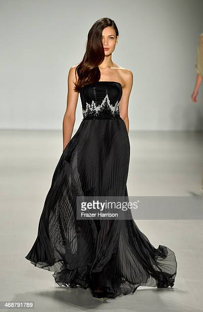 A model walks the runway at the Pamella Roland fashion show during MercedesBenz Fashion Week Fall 2014 at The Salon at Lincoln Center on February 11...