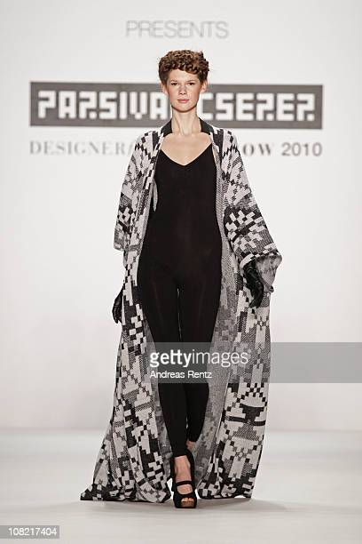 A model walks the runway at the Parsival Cserer Show winner of 'Designer for tomorrow 2010' presented by Peek Cloppenburg during the Mercedes Benz...