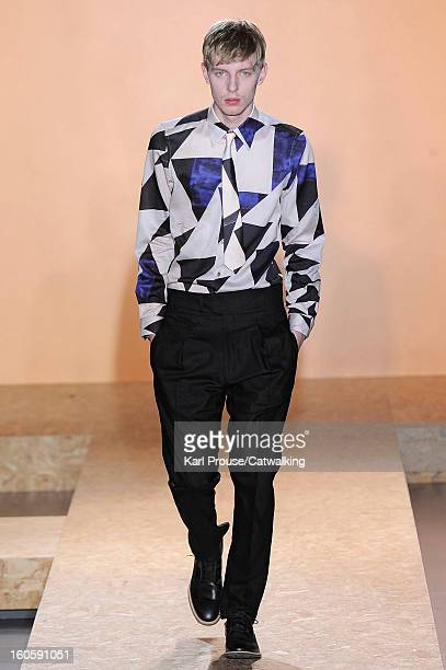 Model walks the runway at the Paul Smith Autumn Winter 2013 fashion show during Paris Menswear Fashion Week on January 20, 2013 in Paris, France.
