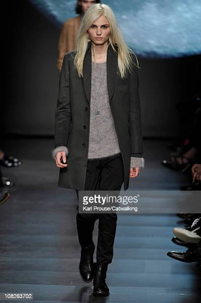 A model walks the runway at the Paul Smith menswear fashion show during Paris Fashion Menswear Week on January 23 2011 in Paris France