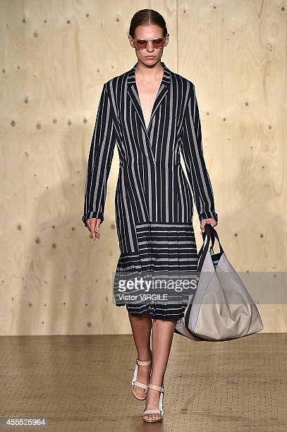A model walks the runway at the Paul Smith Ready to Wear show during London Fashion Week Spring Summer 2015 on September 14 2014 in London England