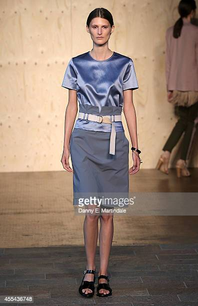A model walks the runway at the Paul Smith show during London Fashion Week Spring Summer 2015 on September 14 2014 in London England