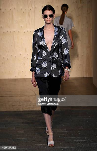 A model walks the runway at the Paul Smith show during London Fashion Week Spring Summer 2015 at on September 14 2014 in London England