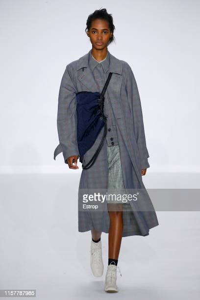 A model walks the runway at the Paul Smith show during Paris Men's Fashion Week Spring/Summer 2020 on June 23 2019 in Paris France