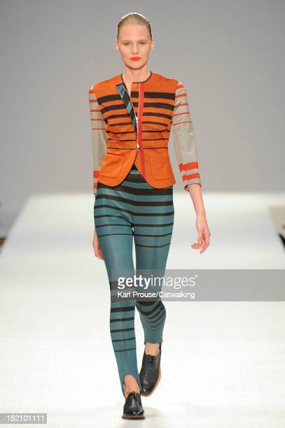 Model walks the runway at the Paul Smith Spring Summer 2013 fashion show during London Fashion Week on September 16, 2012 in London, United Kingdom.