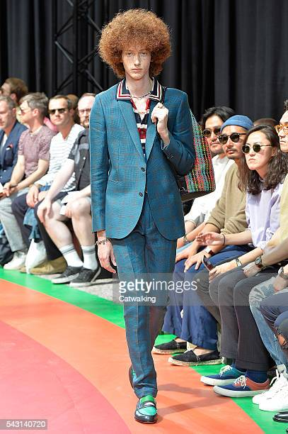 Model walks the runway at the Paul Smith Spring Summer 2017 fashion show during Paris Menswear Fashion Week on June 26, 2016 in Paris, France.