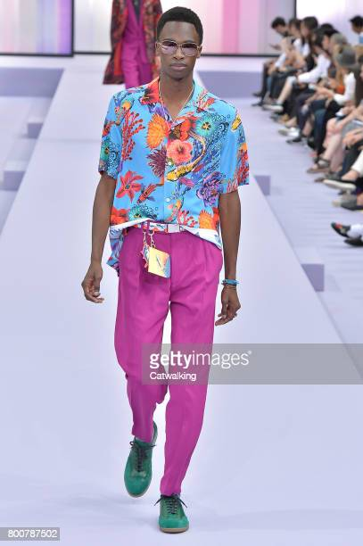 A model walks the runway at the Paul Smith Spring Summer 2018 fashion show during Paris Menswear Fashion Week on June 25 2017 in Paris France