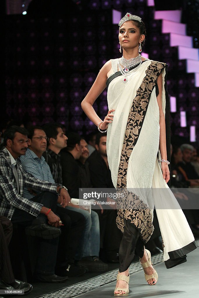 A model walks the runway at the PCJ Grand Finale show of India International Jewellery Week 2012 day 5 at the Grand Hyatt on August 23, 2012 in Mumbai, India.