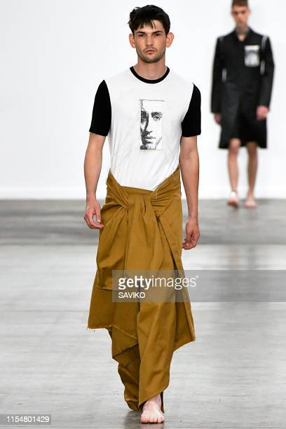 A model walks the runway at the Per Gotesson Ready to Wear Spring/Summer 2020 fashion show during London Fashion Week Men's June 2019 on June 09 2019...