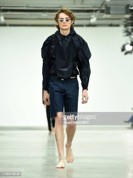 A model walks the runway at the Per Götesson show during London Fashion Week Men's June 2019 at the BFC Show Space on June 09 2019 in London England