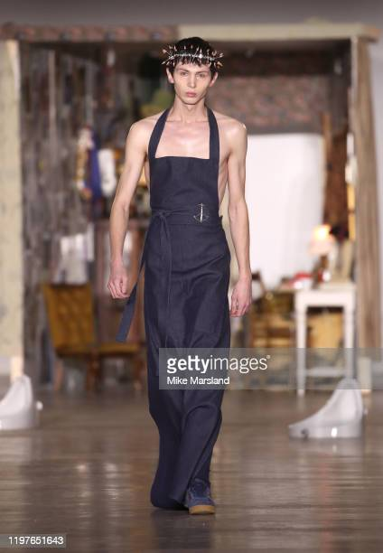A model walks the runway at the Per Götesson show during London Fashion Week Men's January 2020 at the BFC Show Space on January 05 2020 in London...