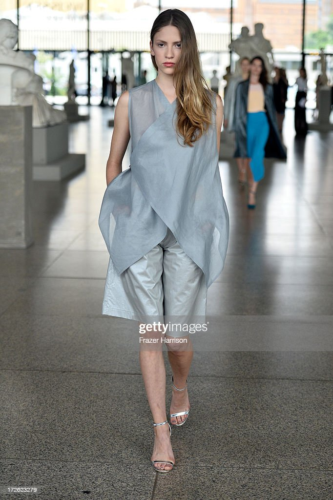 A model walks the runway at the Perret Schaad Show during the Mercedes-Benz Fashion Week Spring/Summer 2014 on July 4, 2013 in Berlin, Germany.