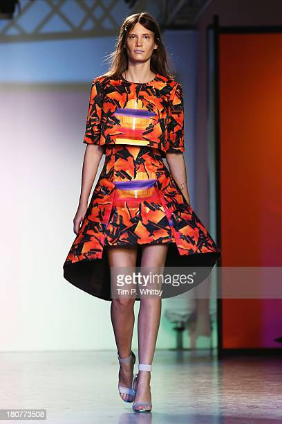 A model walks the runway at the Peter Pilotto show during London Fashion Week SS14 at Victoria House on September 16 2013 in London England
