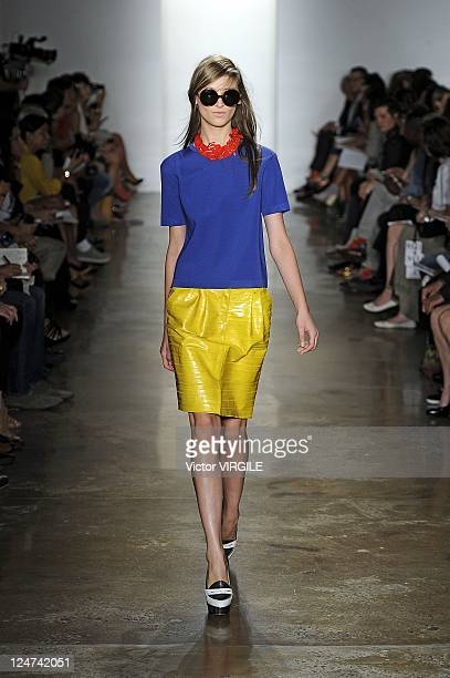 Model walks the runway at the Peter Som Spring 2012 fashion show during Mercedes-Benz Fashion Week at Formula Studios on September 9, 2011 in New...