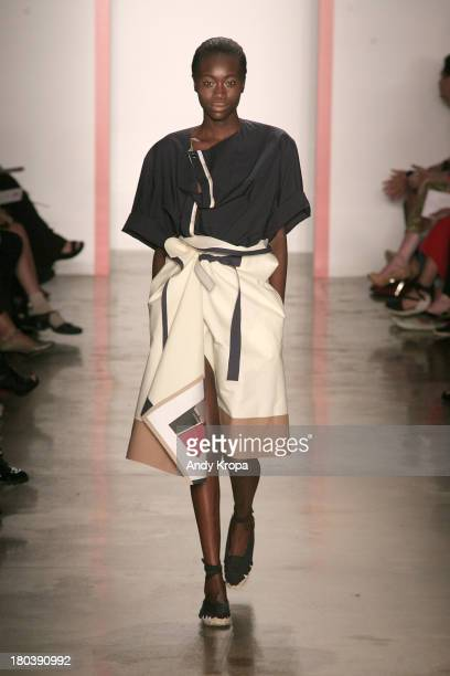 Model walks the runway at the Phase 2 Parsons and MFA fashion design fashion show during MADE Fashion Week Spring 2014 at Milk Studios on September...
